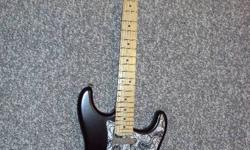 2006 Highway 1 Strat with Seymore Duncan Hot Rails in bridge pos; custom pickguard, 60th anniversary diamond button, chrome accesories and Corona California neck plate. Guitar is mint and comes with Fender padded Gig Bag. $700. 920-4341