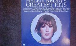 THIS VINYL RECORD ALBUM, HELEN REDDY'S GREATEST HITS, WAS RELEASED BY CAPITAL RECORDS IN 1975. ITS NUMBER IS ST-11467. IT FEATURES THE HIT SONGS I AM WOMAN, ANGIE BABY, DELTA DAWN AND AIN'T NO WAY TO TREAT A LADY. BOTH THE SLEAVE AND RECORD ARE IN GOOD