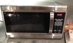 GE Microwave with convection and grill - owned less than a year. Works perfectly and comes with manual. Was $169.00 + tax.