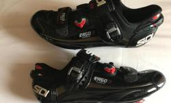 Hello! Top notch SIDI ERGO 3 Vernice Carbon road shoes in excellent condition (the pictures don't do it justice)! Black w/red & silver and Carbon sole. - Carbon Vent Sole - Redesigned heel retention device - Vernice Microfibre and nylon mesh upper -