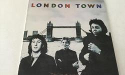 "LONDON TOWN...Album is in Near-Mint Condition...Vinyl is a High Glossy Black, Like New...Complete With Original Inner Sleeve....Quality Vinyl, If That""s What You Collect...Other Wings Albums Available Upon Request..."