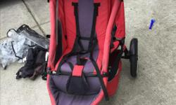 Red Phil and teds stroller. In good condition, kept in garage, pet and smoke free home. Includes extras a pictured.